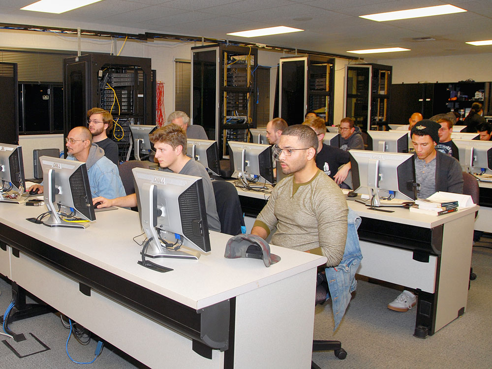 Students work in class at Cisco Networking Academy